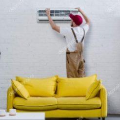 depositphotos_211231730-stock-photo-young-professional-repairman-fixing-air
