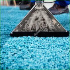 depositphotos_297968830-stock-photo-close-person-cleaning-carpet-vacuum